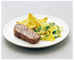 Grilled steak with corn and cucumber salad