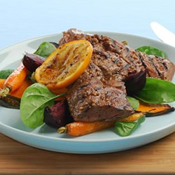 Orange mustard barbecued steaks